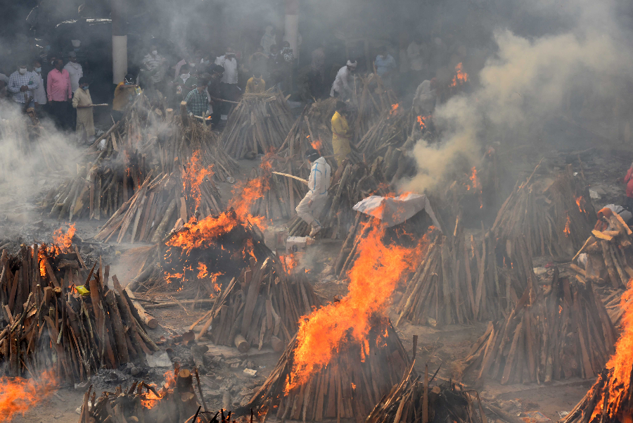 Funeral pyres of people who died of Covid-19 during a mass cremation